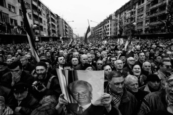 followers of balkans strongman slobodan milosevic gather in his hometown before his funeral, pozarevac, serbia, 2006.
